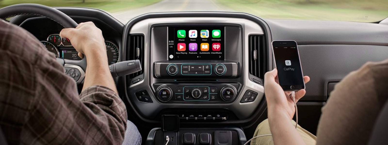 Apple Car Play is being used on a phone in a 2016 Chevy Silverado.
