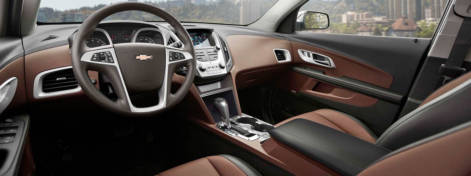 The black and brown interior of a 2016 Chevy Equinox is shown.