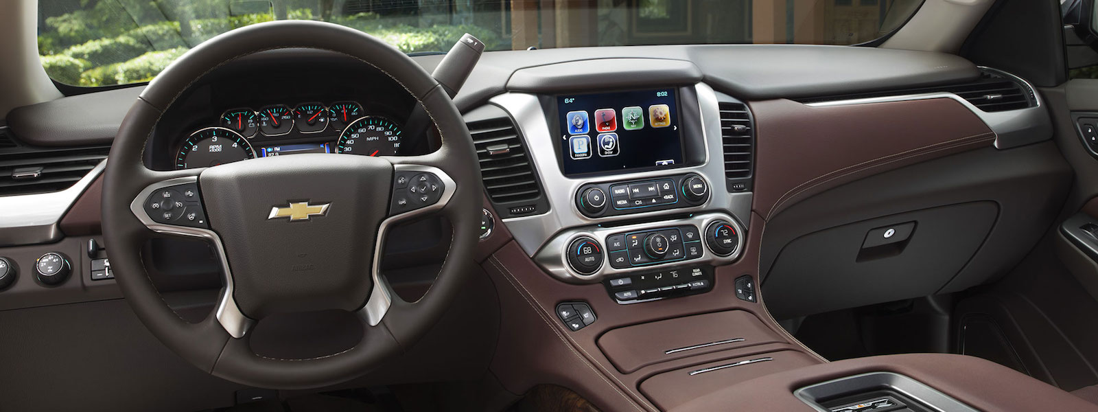 The brown dashboard of a 2016 Chevy Tahoe is shown.