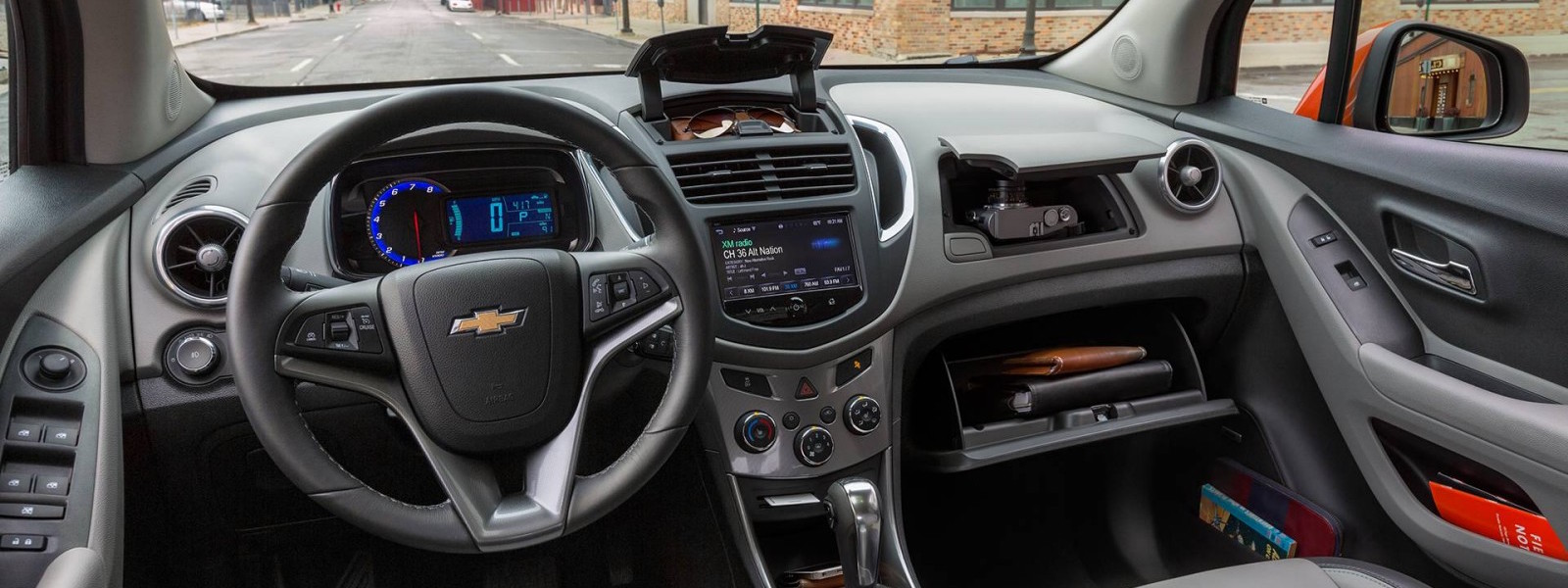 The dashboard features on a 2016 Chevy Trax are shown.