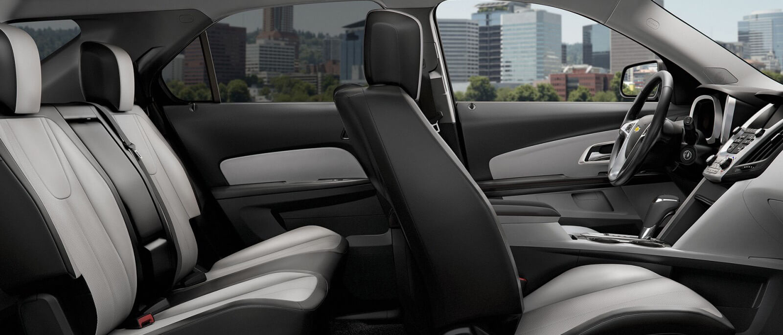 The two rows of seats are shown from the side in a 2017 Chevy Equinox.