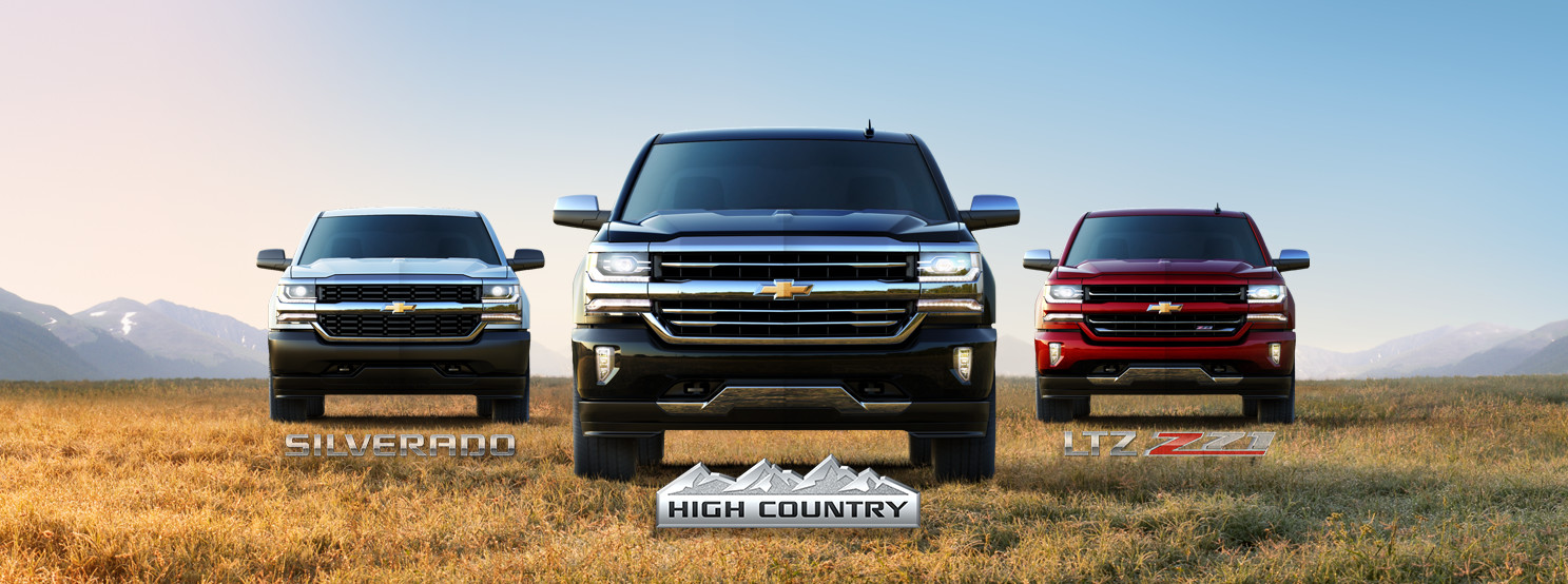 A white 2017 Chevy Silverado 1500, a black Silverado High Country and a red Silverado 1500 LTZ Z71 are shown from the front and parked in a field.