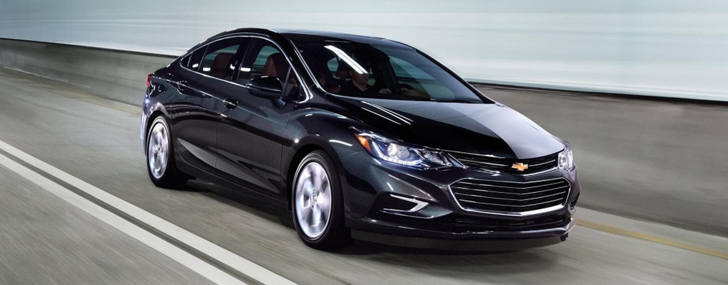 A black 2017 Chevy Cruze sedan is driving in a tunnel near Albany, NY.