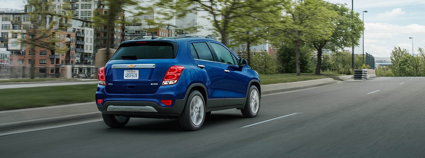 A blue 2017 Chevy Trax is driving on a highway outside Albany, NY.