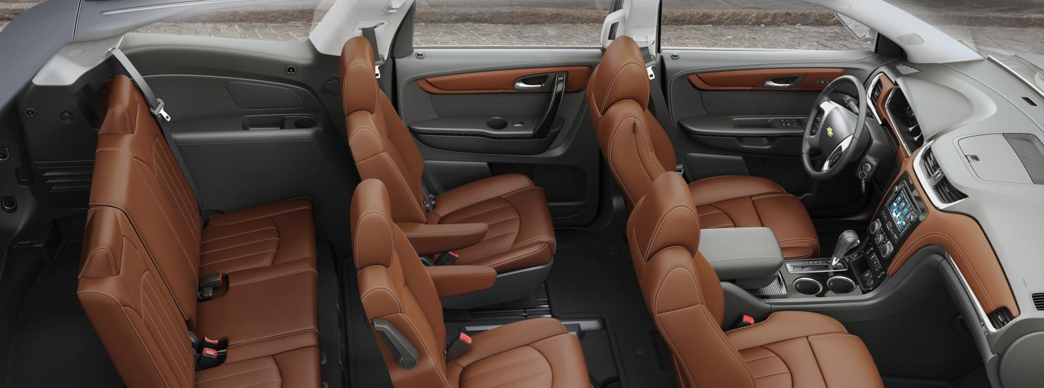 A high angle view shows the three rows of seats in a 2017 Chevy Traverse that is parked on an Albany, NY, street.