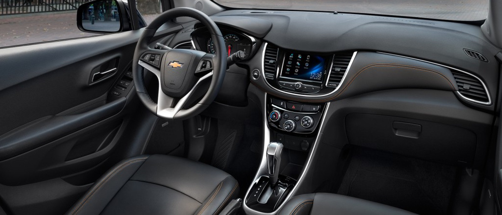 The dashboard and front seats are shown in a 2017 Chevy Trax.