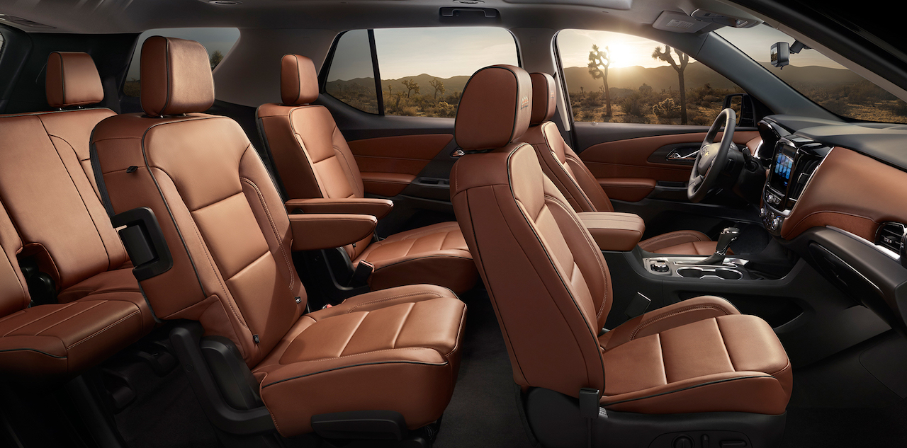 The three rows of brown leather seats are shown in a 2018 Chevy Traverse.