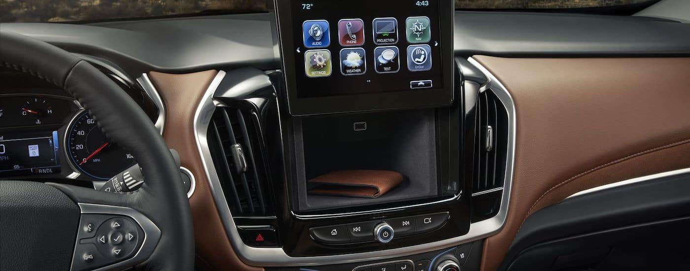 The compartment behind the infotainment screen is shown in a 2018 Chevy Traverse.