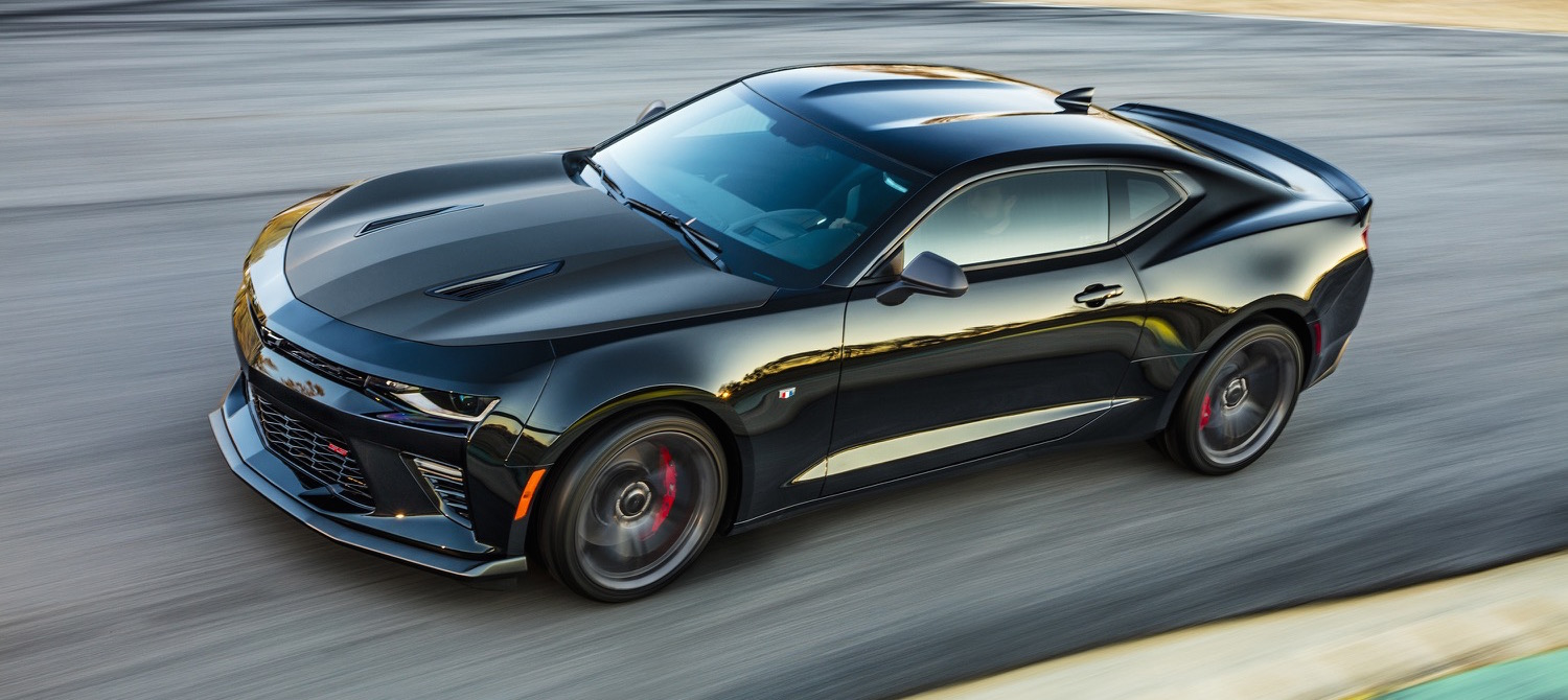 A black 2017 Chevy Camaro is cornering on a track.
