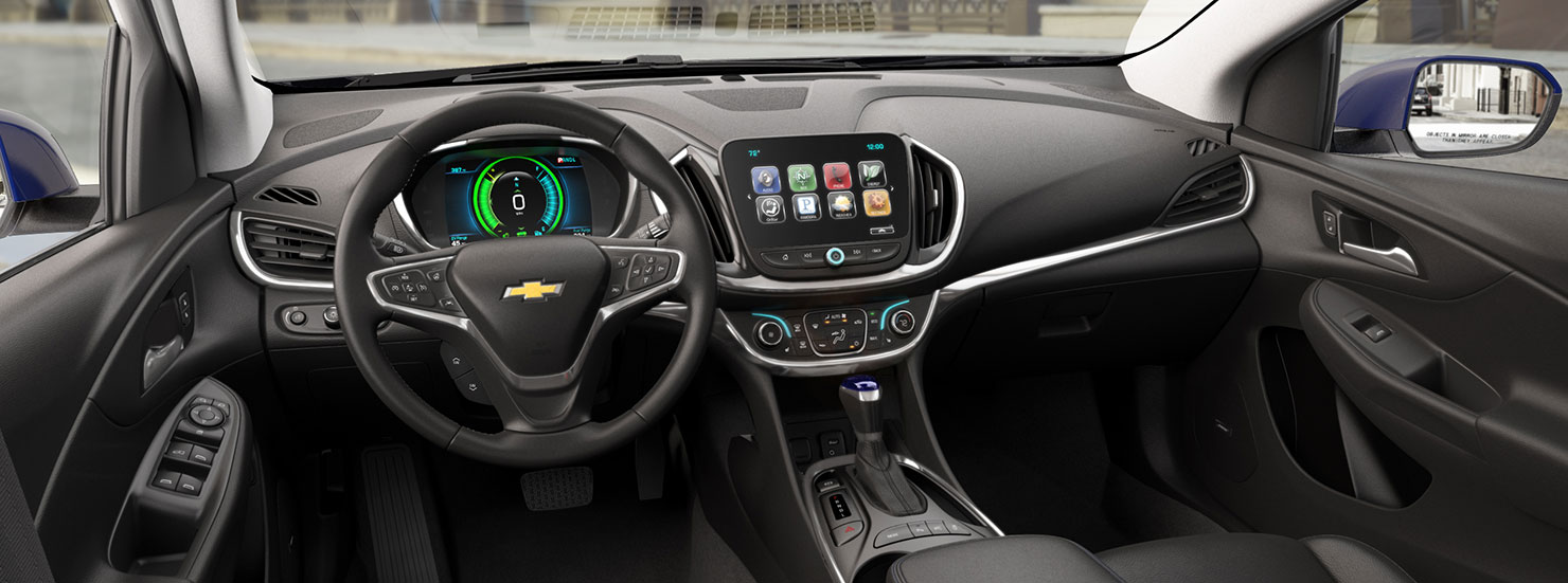 The black interior dashboard is shown in a 2017 Chevrolet Volt on an Albany, NY, street.