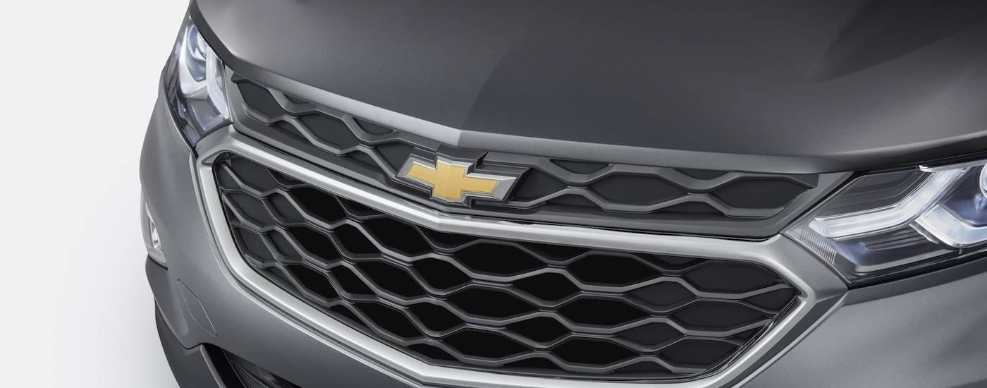 The grille of a gray 2018 Chevy Equinox is shown.