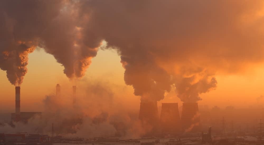 Polluting factory at dawn