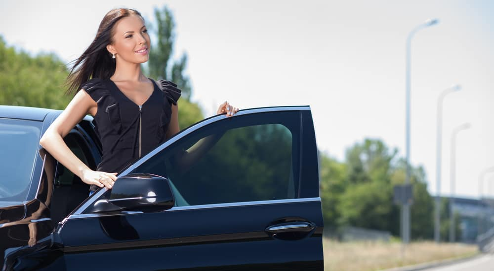 Cheerful young businesswoman is preparing to sit down in transport