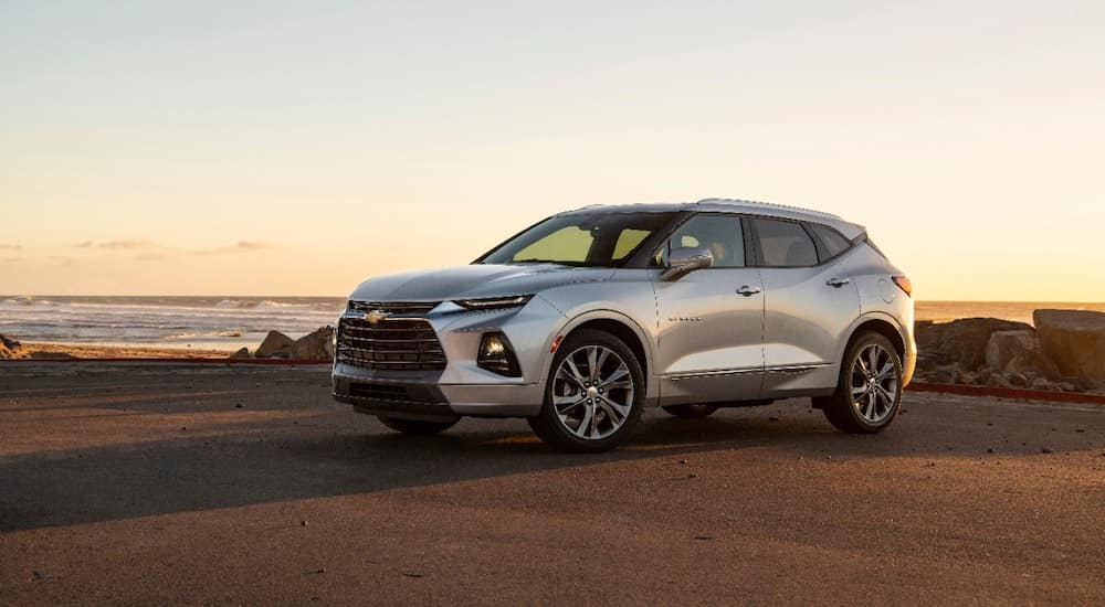 Silver 2019 Chevrolet Blazer Premier SUV parked on dirt in front of a light, clear sky