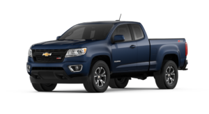 A dark blue 2018 Chevrolet Colorado Z71 is angled left on a white background.