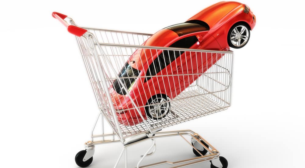 Red toy car in a shopping cart