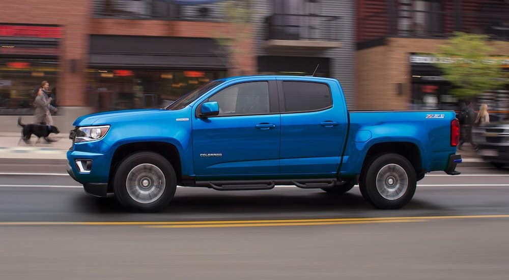 Bright Blue 2019 Chevy Colorado z71 driving in the city
