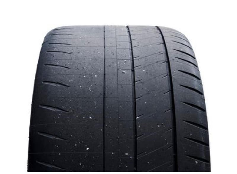 Black rubber tire showing uneven and significant tread loss on the left side