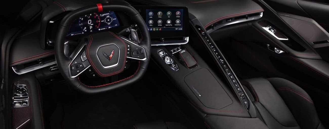 The black interior of a 2020 Chevy Corvette is shown.