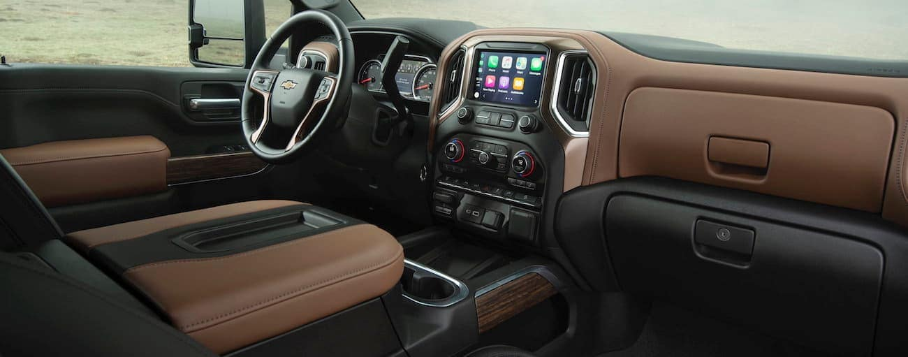 The black and brown interior of a 2020 Chevy Silverado HD is shown.