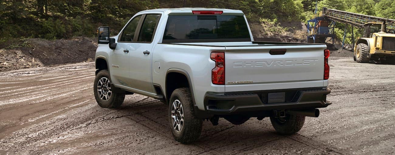 A white 2020 Chevy Silverado is parked at a construction site.