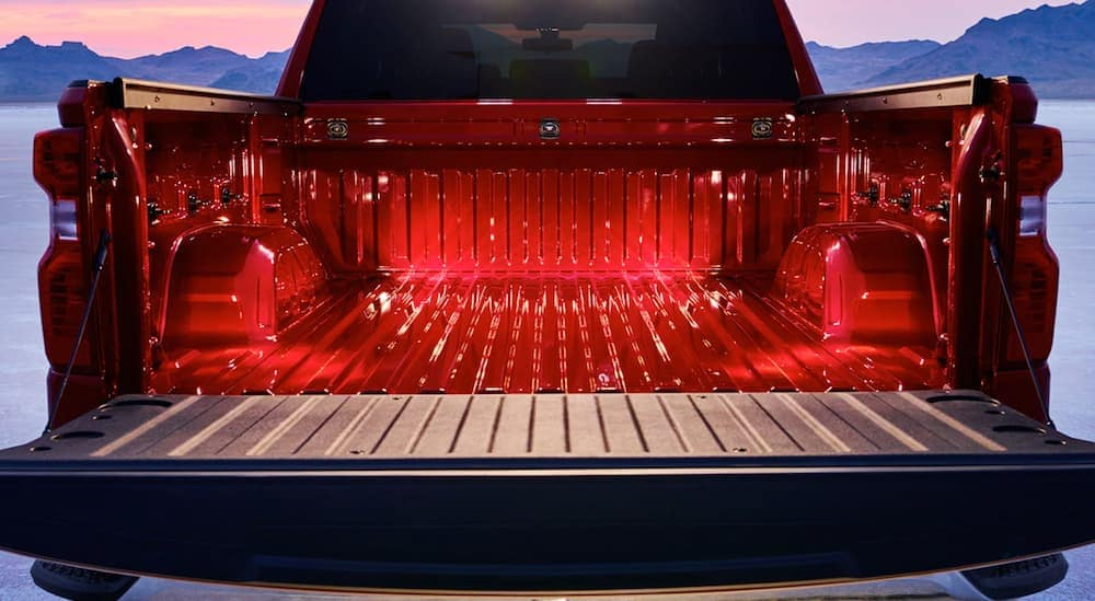 The bed of a red 2020 Chevy Silverado is shown with the standard 12 tow points.
