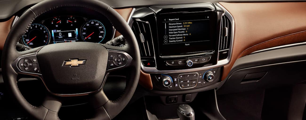 The dashboard and brown interior of the 2020 Chevy Traverse is shown.
