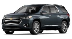 A graphite 2020 Chevy Traverse is facing left.