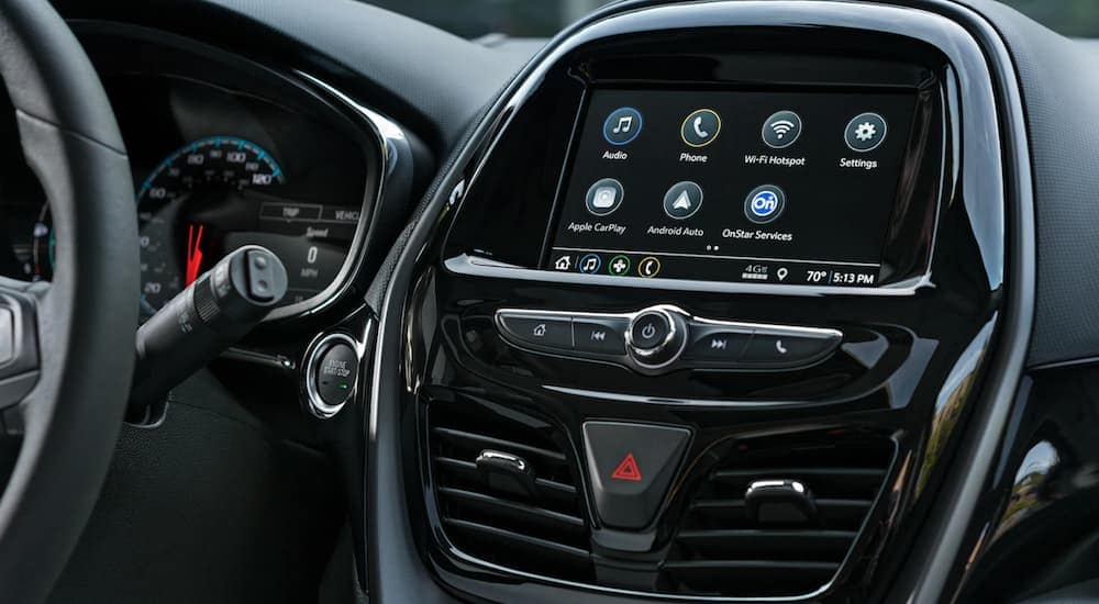The touchscreen on a 2020 Chevy Spark is shown, which is popular among new Chevy vehicles.