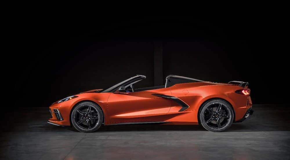 An orange 2020 Chevy Corvette is parked in a dark garage near Albany, NY.