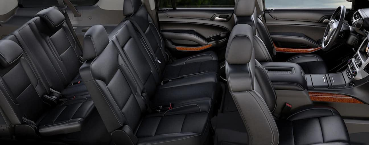 A birds eye view of the black leather interior of a 2020 Chevy Suburban is shown.