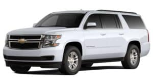 A white 2020 Chevy Suburban is facing left.