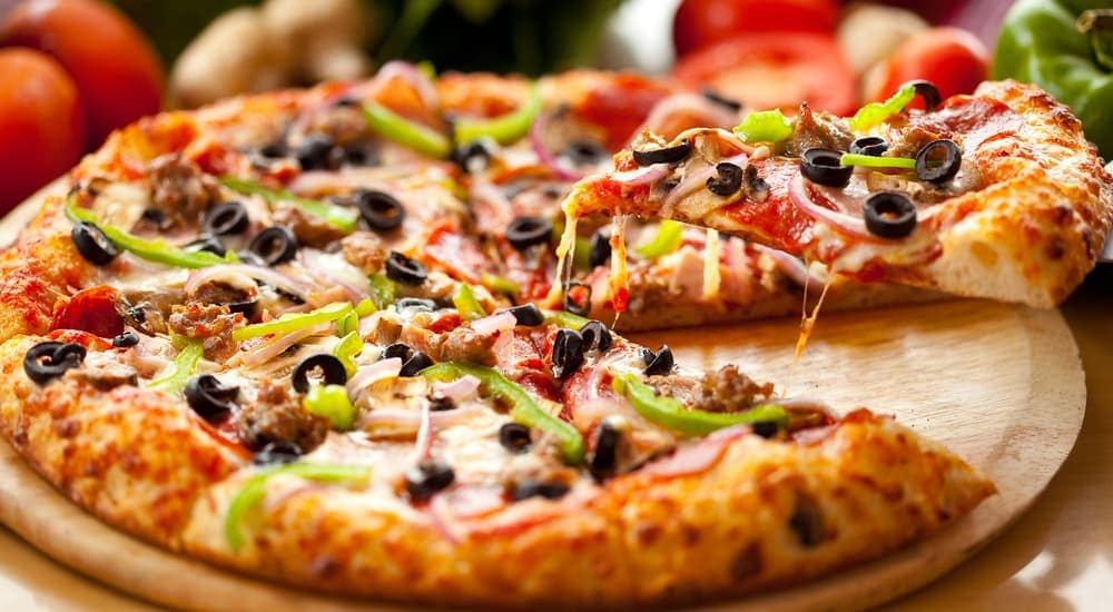A specialty pizza that you could find in Albany, NY is shown.