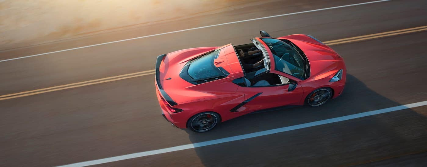 A red 2020 Chevy Corvette is shown from about on a paved road.