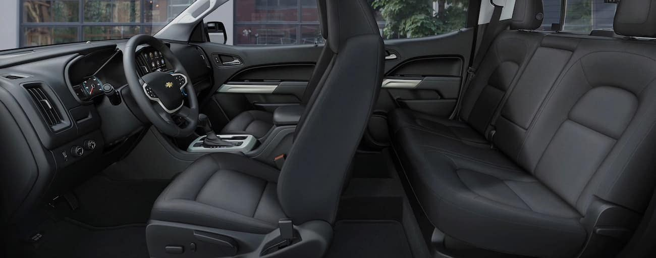 A side view of the black front and rear interior of a 2020 Chevy Colorado is shown.