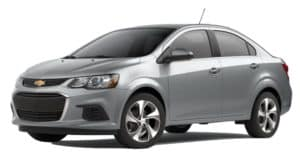 A grey 2020 Chevy Sonic is facing left.
