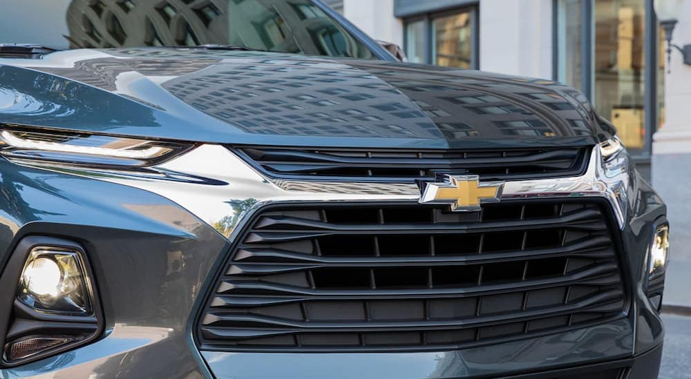 A close up of a blue 2019 Chevy Blazer's front grille is shown.