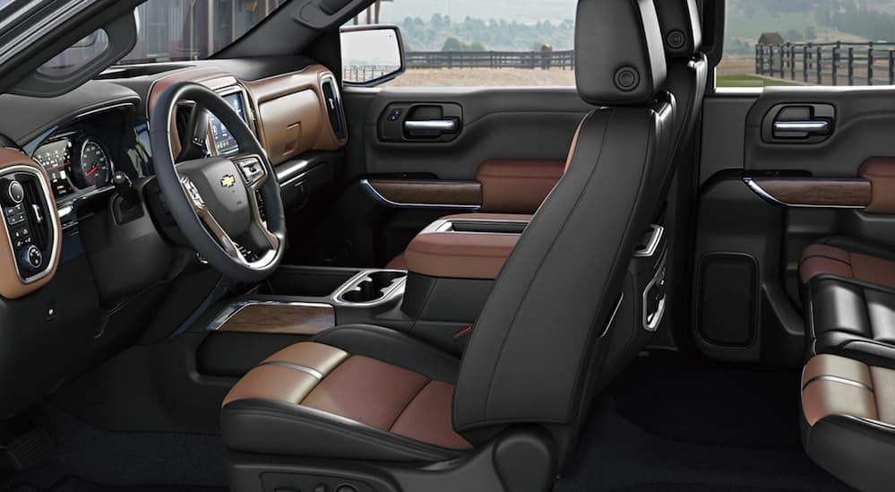 A side view of the black and brown leather interior of a 2020 Chevy Silverado 1500 is shown.
