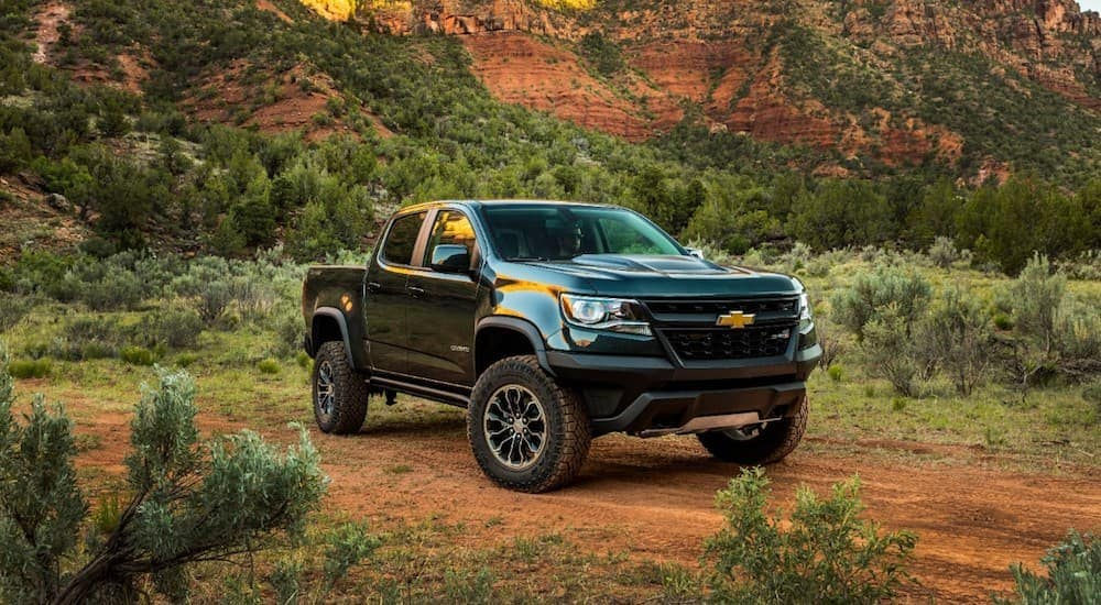 A black 2020 Chevy Colorado ZR2, which comes with a diesel engine as an option, is parked on a dirt road.