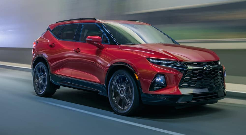 A red 2020 Chevy Blazer, a vehicle that you could get great Chevy lease deals on, is driving on a highway near Albany, NY.