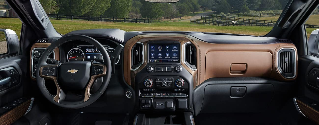 The brown and black interior of a 2020 Chevy Silverado is shown.