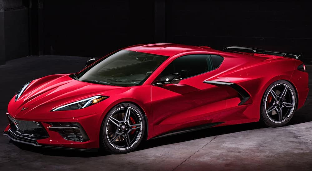 A red 2020 Chevy Corvette is parked in a dark lit garage near Clifton Park, NY.