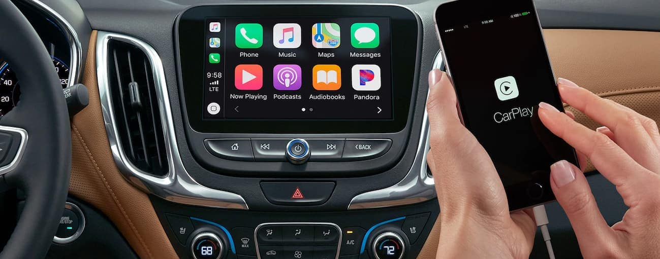 A close up of the touchscreen in a 2020 Chevy equinox is shown while an iPhone is connected.