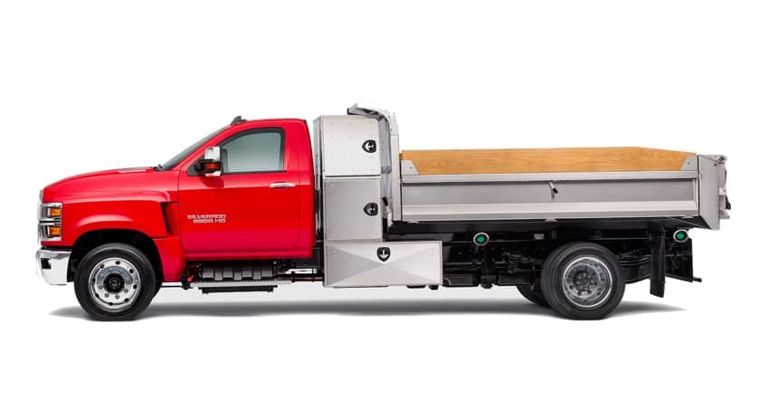A red 2021 Chevy Silverado 5500 HD is shown from the side, facing left.