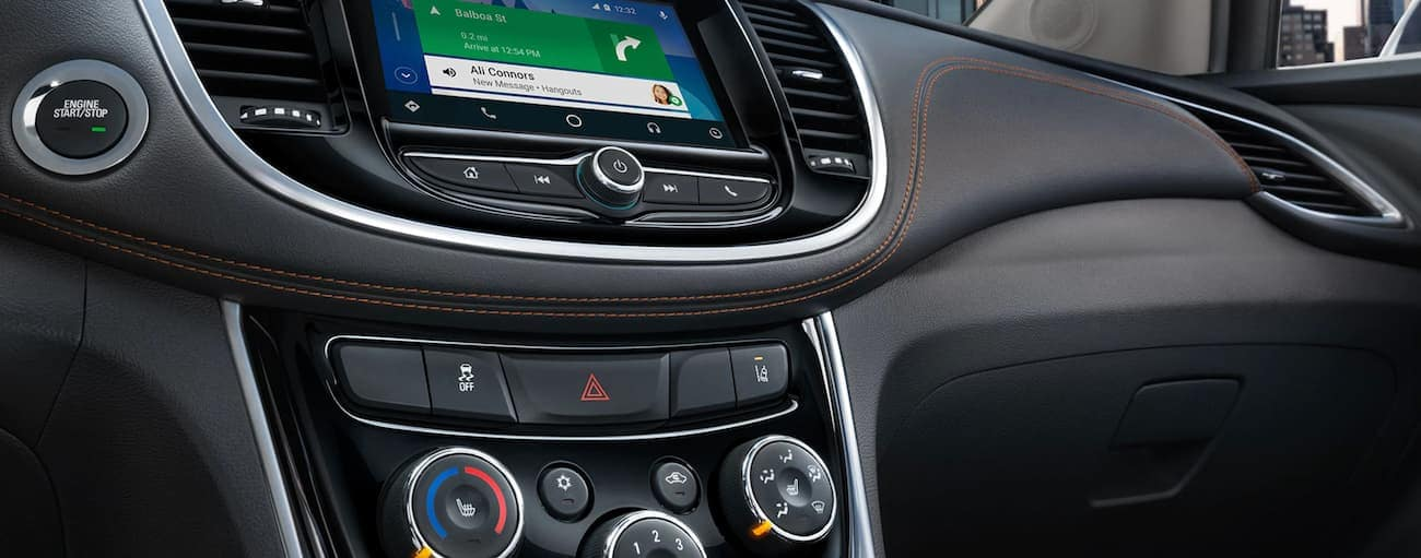 The infotainment screen and temperature controls are shown on the 2020 Chevy Trax.