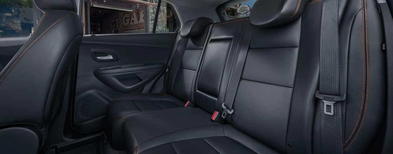 The 2020 Chevy Trax's back seat with black interior is shown.