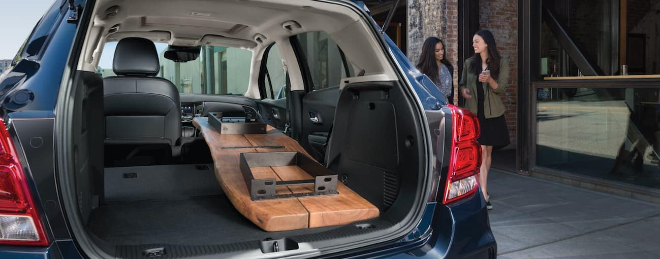 The liftgate of a 2020 Chevy Trax is open with a table in the cargo area.