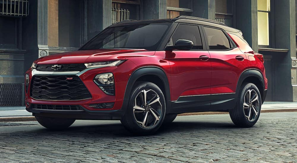A red 2021 Chevy Trailblazer is parked on a cobble stone road.
