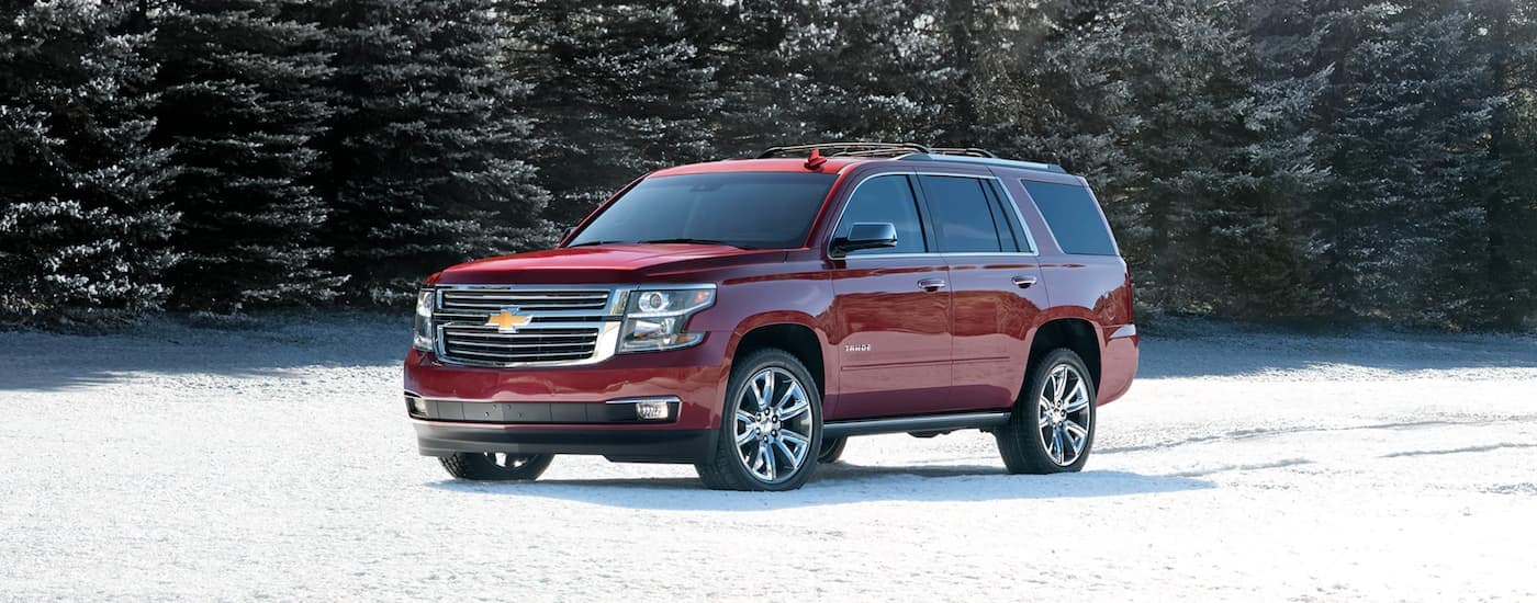 A red 2020 Chevy Tahoe is parked in the snow in Albany, NY.