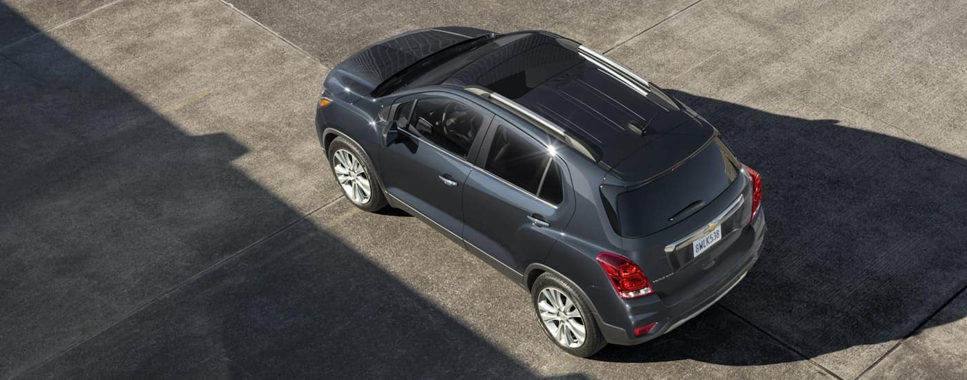 A dark grey 2020 Chevy Trax is shown from above in a parking garage.